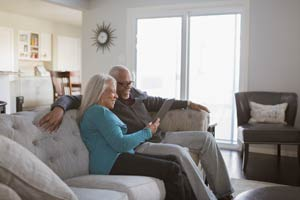 Couple Looking at Genetic Results on the Couch