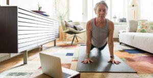 woman practicing virtual yoga